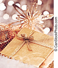 Golden Christmas gift with baubles decorations - Golden gift...