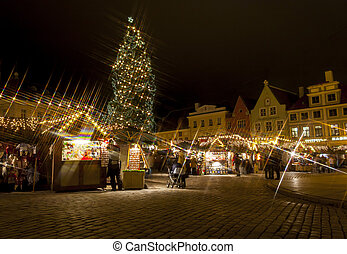 Snowless Christmas market around fir tree in the Old Town of...