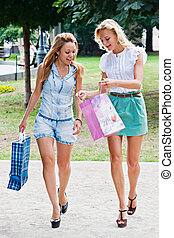 Two girls walking in the park