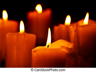 Warm candlelight - Photo of candle isolated on black...