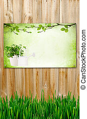 Wooden background with painting and grass