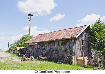 old barn in farm with carriage wheel
