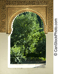 Islamic motifs arch window and green garden outside