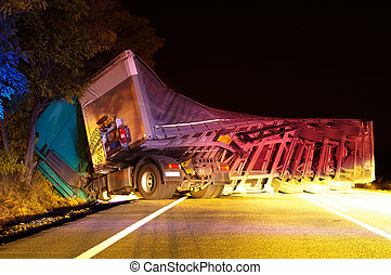 Overturned truck in crash. Night Photo