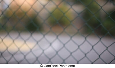 prison - woman behind fence wires