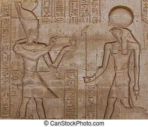 Egyptian engraved gods on wall in Kom Ombo temple, Egypt