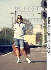 Hipster girl at railways platform