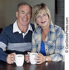 mature couple together - happy senior couple is having...