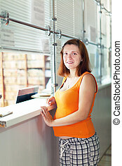 Pregnant woman waiting  for patient's records