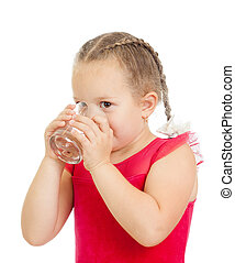 pretty little girl drinking water from glass over white...