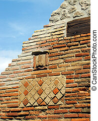 a Phallic symbol on the wall - Decorative brickwork on one...