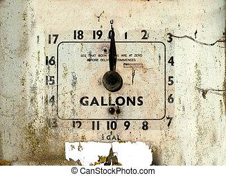 Old broken gas or petrol station dial