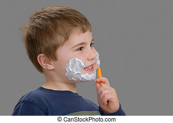 Time for a shave - Young boy, with shaving cream on his...