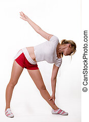 Woman stretching - Full body of an attractive blond woman in...