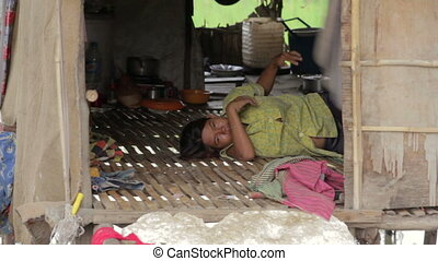 Mother cradle baby in slum