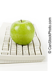 online learning - green apple and computer keyboard, concept...