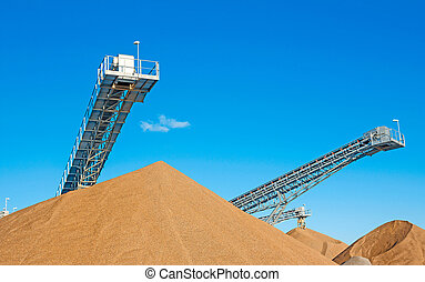 conveyor open workings - Conveyors and gravel heaps at an...