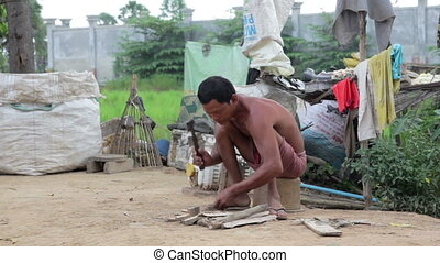 Father in slums preparing fire