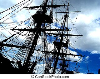 tall ship silhouette - A stationary tall ship in front of...