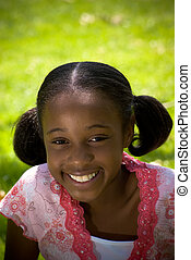 African-American Girl Smiling - a young african-american...