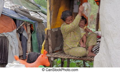 Mother feeding baby in slums