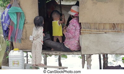 Cambodian family in slum