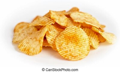 Potato chips are rotating on white - Potato chips are...