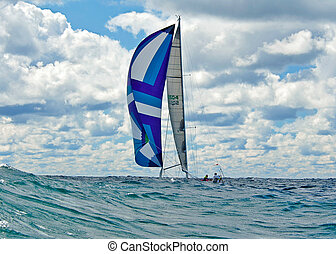 sailboat with spinnaker - Sailing on high seas with colorful...