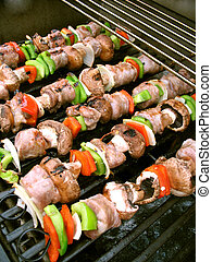 Shish Kebabs on the Grill - Sausage shish kebabs on skewers,...