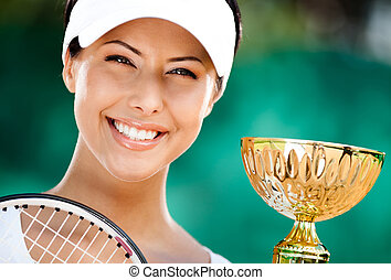 Successful tennis player won the cup - Tennis player won the...