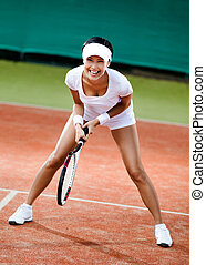 Female tennis player at the clay tennis court - Tennis...