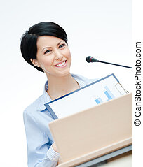 Female executive at the podium - Female lecturer at the...