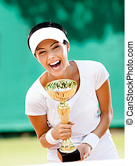 Young female tennis player won the tournament - Successful...