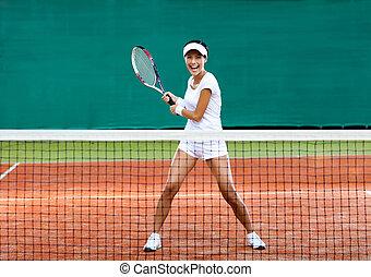 Sportswoman plays tennis - Woman in sportswear plays tennis...