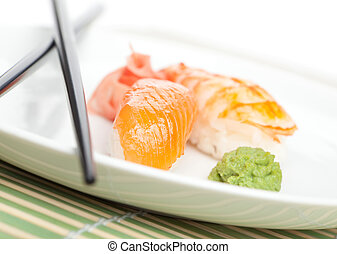 Taking sushi from the plate - Taking nigiri sushi from the...