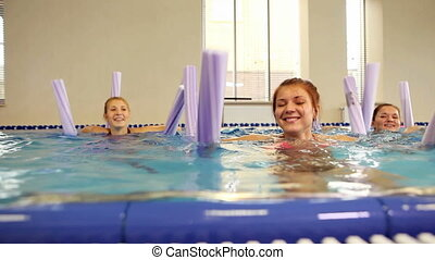 Aqua exercise - Healthy women with aqua tubes doing exercise...