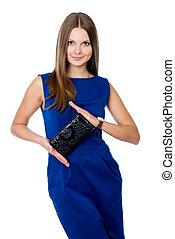 Beautiful girl with black purse