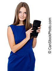 Beautiful girl with black purse isolated on white background...