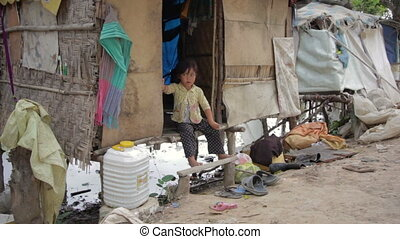 Cambodian kid eating in slums