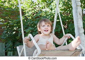 Laughing child on swing - Laughing child on swing in summer...