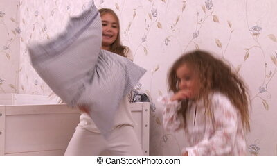 Little girls play on bed - HD 1080p - Big sister and little...