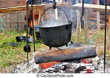 Camp fire cooking 3 - A black pot on an outdoor open fire