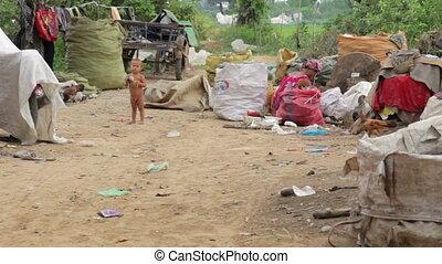 Naked kid and garbage gatherer