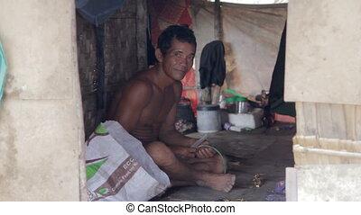 Adult man inside shack shanty