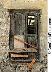 boarded up old window shutter