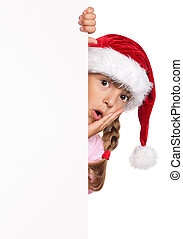 Little girl in Santa hat - Portrait of happy little girl in...