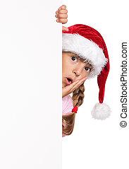 Little girl in Santa hat - Portrait of happy little girl in...