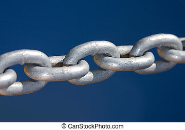 Chain links - Close up of large silver coloured links in an...