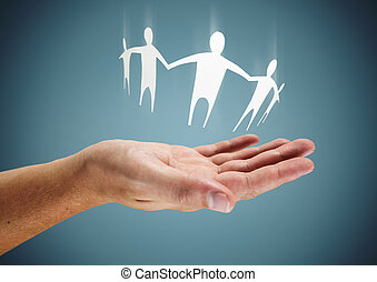 Family in Hand - Caring or helping conceptual image.