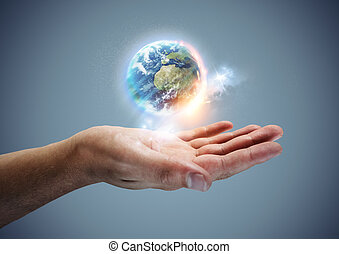 Your World -  The planet earth hovering in a hand.
